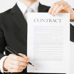 man-in-suit-holding-contract-paper 2
